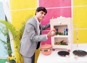 Manshuk Prajapati showing his clay refrigerator