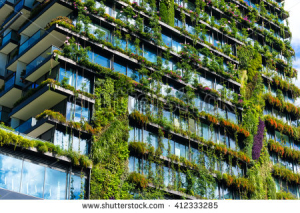stock-photo-green-skyscraper-building-with-plants-growing-on-the-facade-ecology-and-green-living-in-city-412333285