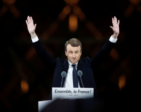 French President-elect Emmanuel Macron celebrates on the stage at his victory rally near the Louvre in Paris, France
